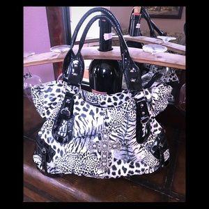 Handbags - Animal print purse with cross